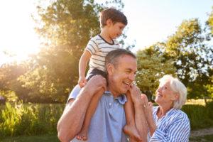 Grandparents Giving Grandson Ride On Shoulders